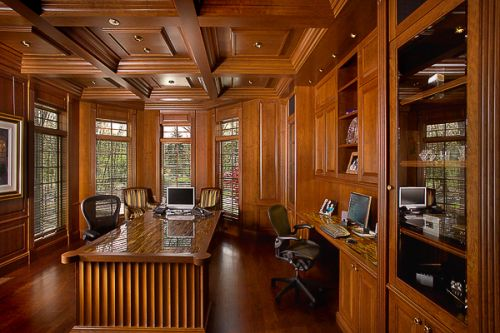 Custom furniture, custom wood ceiling, wood floors, stone insert top of desk