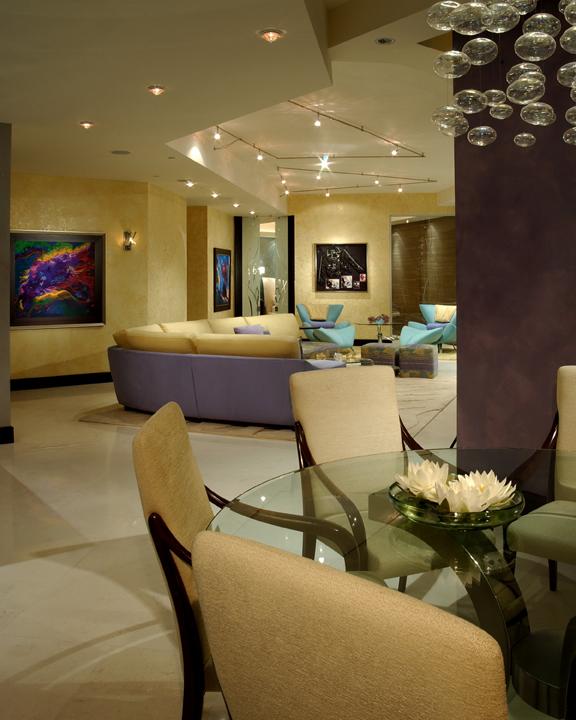 Custom designed cabinetry, glass dining table, stone floors,  custom lighting