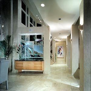 Custom cabinetry, custom glass design, faux finished walls, stone floor