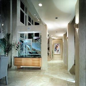 Custom cabinetry, custom glass design, faux finished walls, stone floor