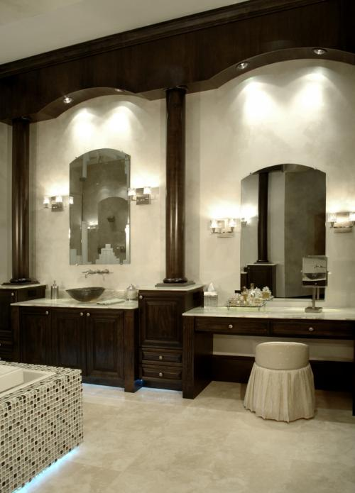 Glass Vessel Sink, Wall sconces, custom mirrors, custom wood cabinets