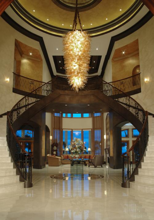Custom glass chandelier, custom iron railing, faux finishing, marble floors,