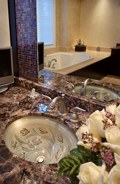 Stone top, undercount glass sink, pewter faucet, custom cabinetry