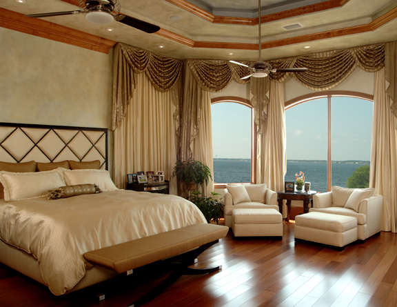 wood floors, custom draperies, upholstered bed