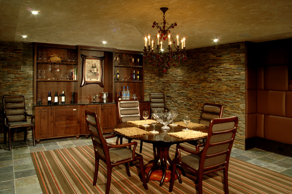 Custom furniture, slate floors, stone walls, upholstered walls, custom cabinetry.