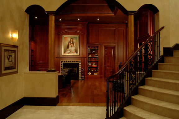custom paneling, custom wood furniture, wood floor, stone floor and staircase, faux finishing