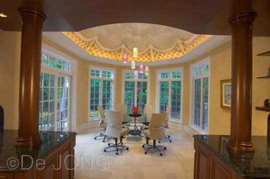 Recessed lighting, perimeter lighting, contemporary chairs, glass table