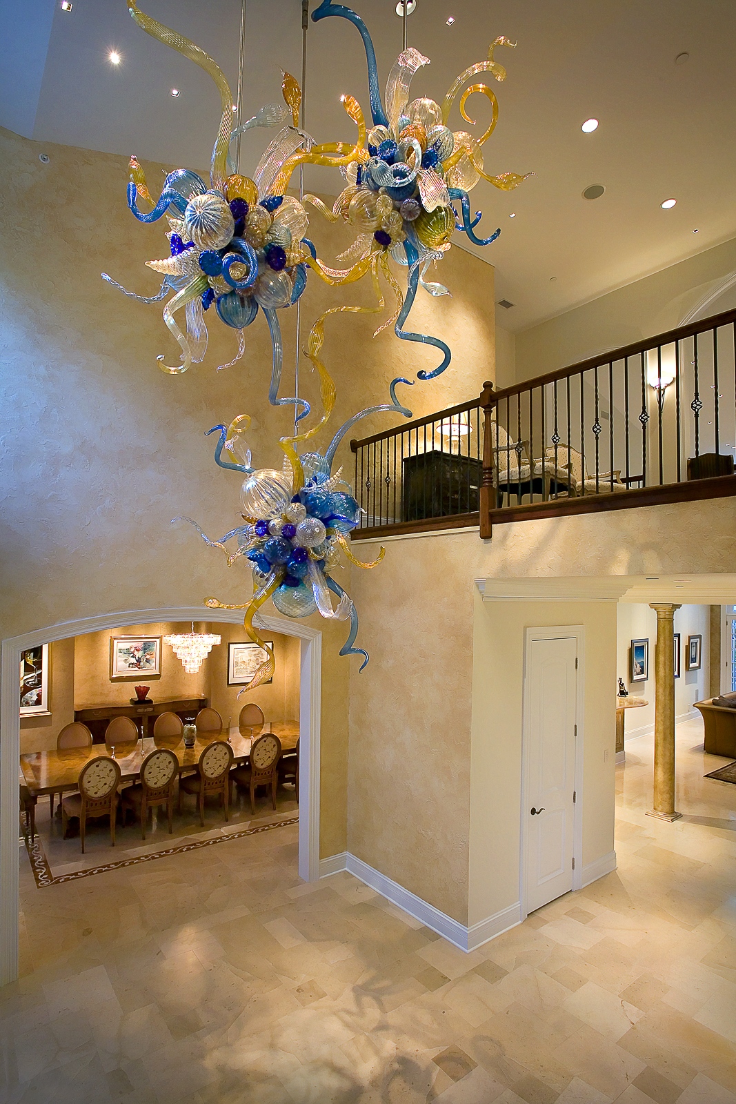 Custom designed Chihuly fixture, dining room, foyer, brass and wood railing, faux finished walls