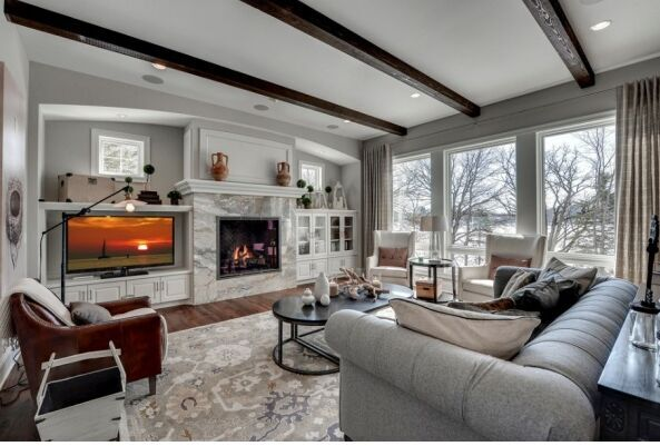 wood floors, area rug, custom furniture, stone fireplace
