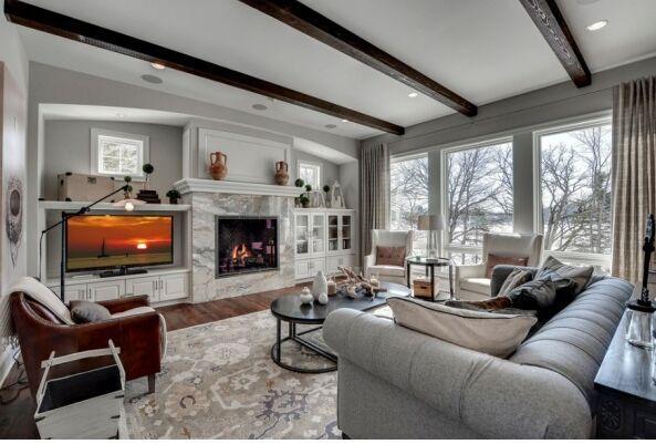 wood floors, area rug, custom furniture, stone fireplace