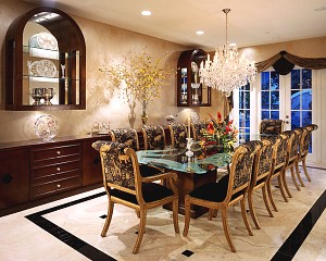 Faux finish, custom cabinets, custom glass table, crystal chandelier, stone floors, inlay